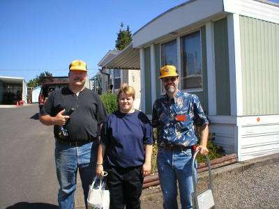 Lion Doug Ballou (right) working with Rich Lessing & son at the Smoke Detector/Replacement project